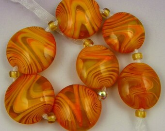 a set of 7 large lentil beads in bright coral and transparent yellow handmade lampwork glass beads - Spin Me Round