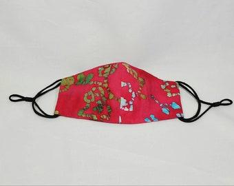 Fushia Pink Batik Cloth Face Mask with splashes of olive green and blues