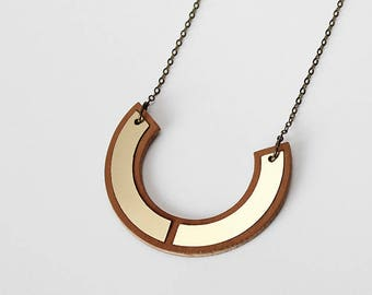 Minimalist and modern half circle horseshoe shape marquetry necklace - brass, gold color and wood