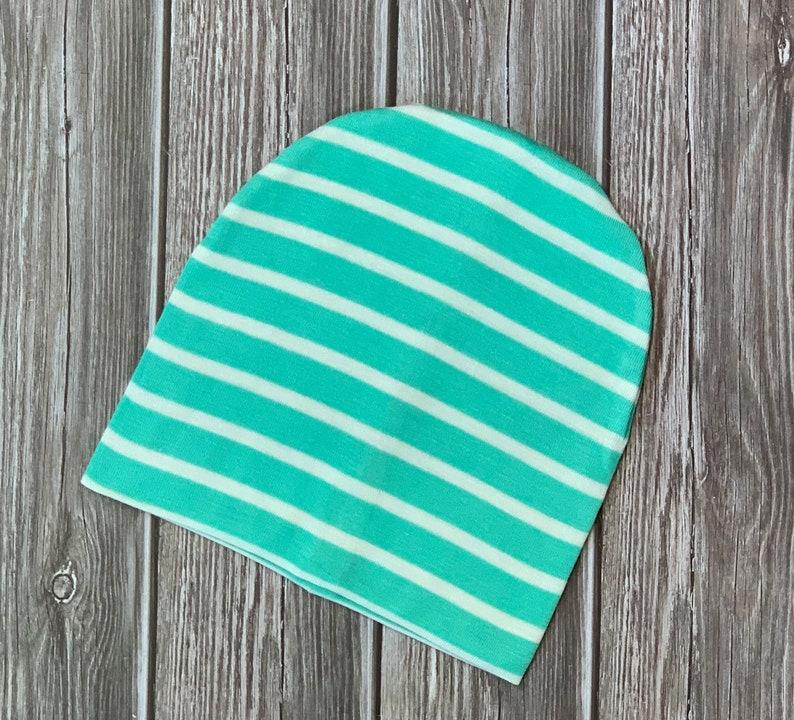 Newborn slouch beanie in green stripe jersey knit
