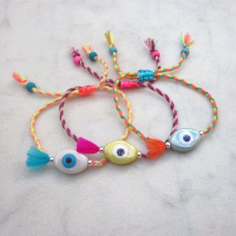 0383511560e Evil eye bracelet/ hippie cord friendship bracelet/ colorful image 0 ...