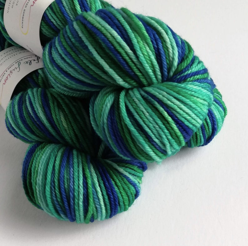Hand dyed superwash merino worsted weight wool yarn. image 0
