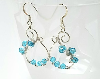 Wire wrapped silver and blue crystal earrings