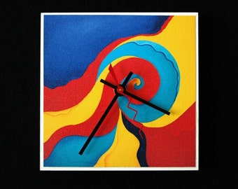 Abstract art clock with vivid reds, blues and yellows.