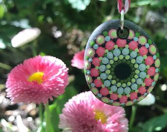 hand painted mandala stone pendant in pinks, greens, & blues