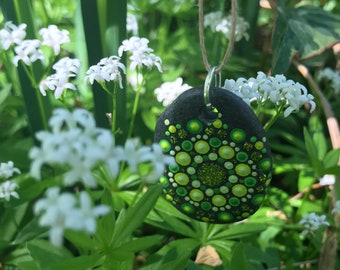 hand painted mandala stone pendant in shades of green