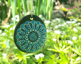 hand painted mandala stone pendant in shades of blue