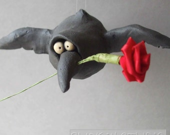 Flying Black Bird or Crow Ceramic Sculpture with Rose