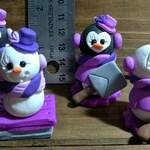 Set of four snowman penguin ornaments