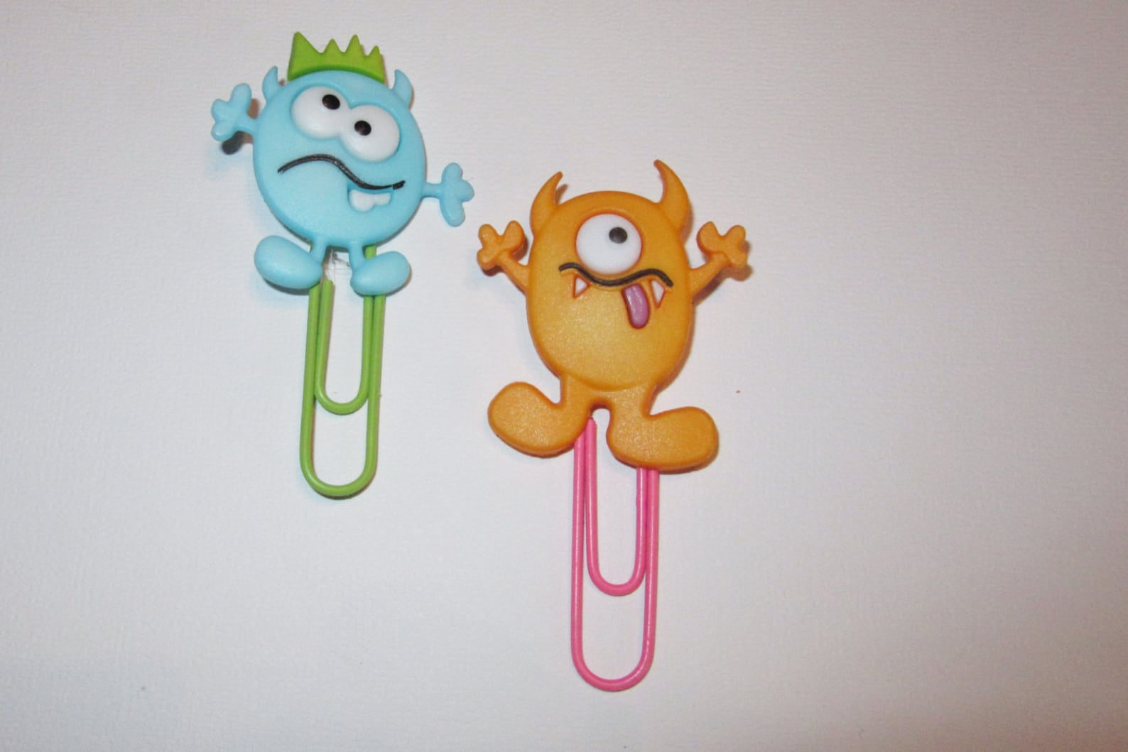 Two paperclip monster bookmarks against a white background.