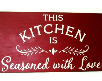 This kitchen is seasoned with love wood sign