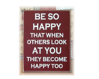 Be so happy that when others look at you they become happy too. Typography wood sign