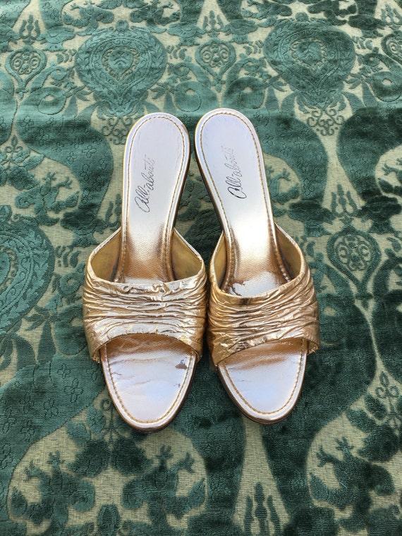 Vintage gold slippers