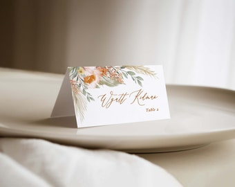 printed boho wedding place cards accented with sage, terracotta and pampas grass, folded escort cards for bohemian wedding with  earth tones