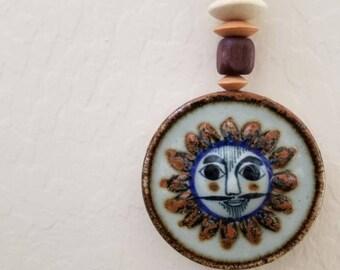 Mexican talavera tile wall pendant.