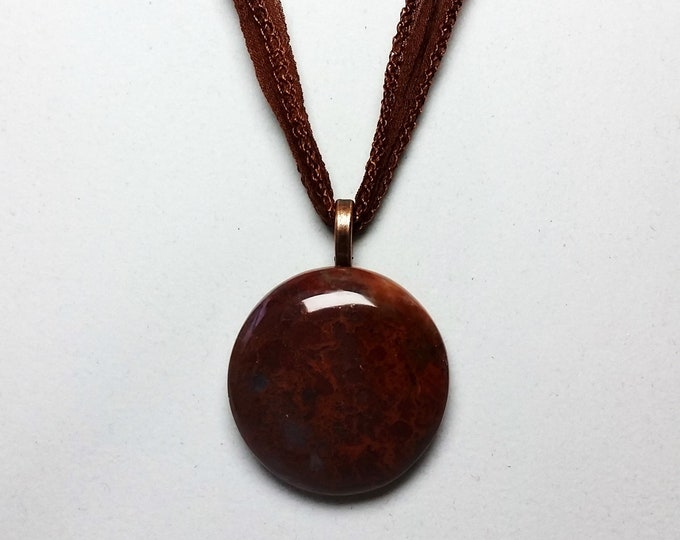 Fossil Dinosaur Bone Pendant - Reddish Brown Circular Dinosaur Bone Pendant on Soft Chocolate Brown Fairy Ribbon