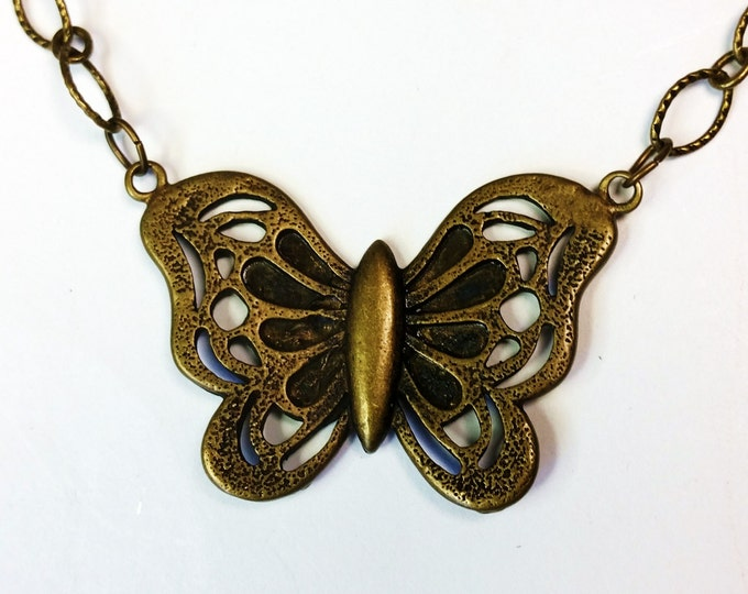 Perky Antique Brass Butterfly Pendant on Etched Oval Link Chain