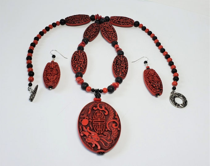 Good Luck Symbols in Carved Cinnabar Pendant Necklace with Earrings - Long Red Cinnabar & Black Lava Necklace w Oval Pendant and Earrings