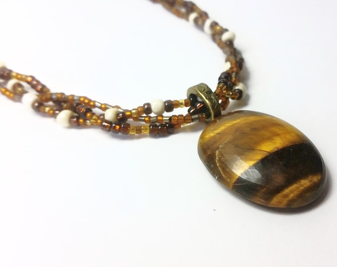 Tigers Eye Cabochon Pendant on Braided Beaded Brown Earthy Toned Necklace - Luster Light-play Adjustable Length Tigers Eye Pendant Necklace