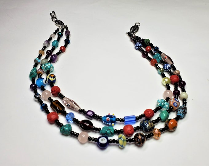Vivid Colors of the Rainbow Triple Strand Necklace With a Potpourri of Beads in Varying Shapes, Textures, and Sizes