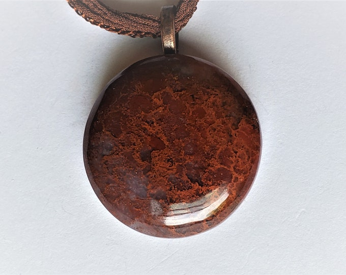 Dinosaur Bone Fossil Pendant - Reddish Brown Circular Cabochon Dinosaur Bone Pendant on Soft Chocolate Brown Fairy Ribbon