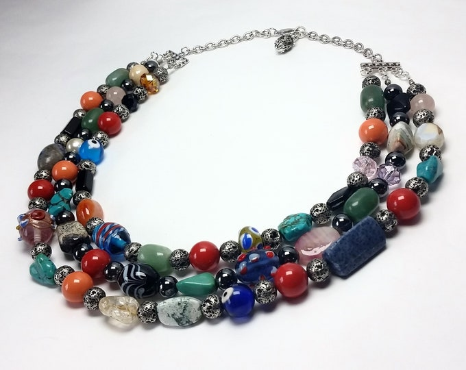 Over the Rainbow Triple Strand Necklace With a Melange of Beads in Varying Shapes, Textures, Sizes and Colors