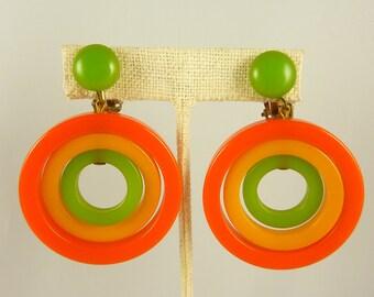 Vintage Orange Yellow and Green Spinning Circles Bakelite Large Hoop Clip Earrings