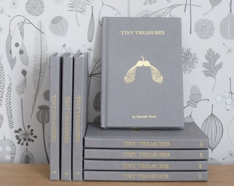 Tiny Treasures book by Hannah Nunn, an identification guide to the seeds and pods on your tiny treasures wallpaper or out in the woods