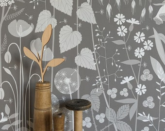 Hedgerow wallpaper in 'pipit' by Hannah Nunn, a warm brown botanical wall covering with a wild tangle of plants and flowers