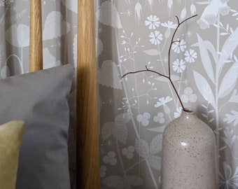 SAMPLE Hedgerow wallpaper in 'hush' by Hannah Nunn, a soft grey/pink botanical wall covering with a wild tangle of plants and flowers