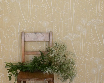 Paper Meadow wallpaper in 'harvest' by Hannah Nunn, a warm, yellow botanical wall covering with meadow seed heads and grasses