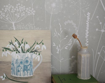 Paper Meadow wallpaper in 'brume' by Hannah Nunn, a grey/green botanical wall covering with meadow seed heads and grasses