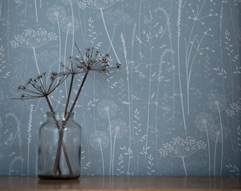 Paper Meadow wallpaper in 'teal' by Hannah Nunn, a blue floral botanical wall covering with meadow seed heads and grasses