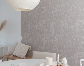 Paper Meadow wallpaper in 'mallow' by Hannah Nunn, a grey/pink, botanical wall covering with meadow seed heads and grasses