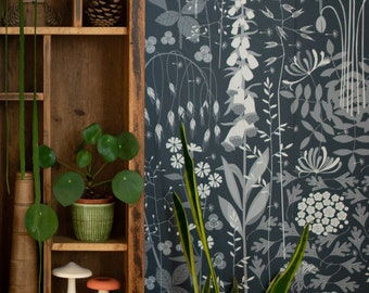 SAMPLE Hedgerow wallpaper in 'nocturne' by Hannah Nunn, a deep, dark blue botanical wall covering with a wild tangle of plants and flowers