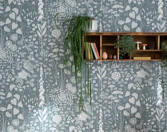 Hedgerow wallpaper in 'furling' by Hannah Nunn, a  blue/green botanical wall covering with a wild tangle of plants and flowers
