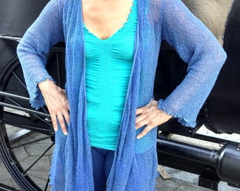 NEW color Denim Blue 43.99 Buttery soft Beautiful simple and elegant denim blue cardigan. Great for vacation, out to dinner, anywhere.