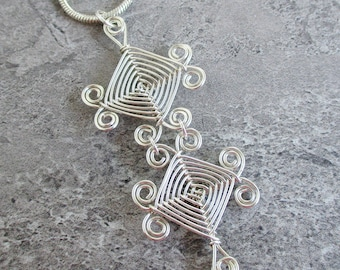 Hand Woven Sterling Silver Wire Pendant- Double Scroll Ojos Pendant