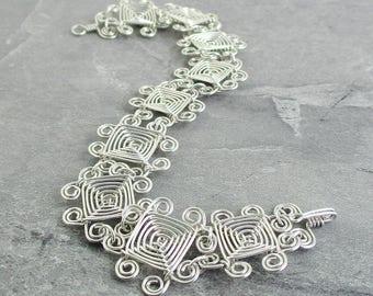 Hand Woven Sterling Silver Wire Bracelet- Scroll Ojos Bracelet