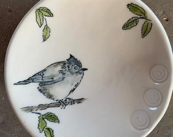 Bird on a small trivet