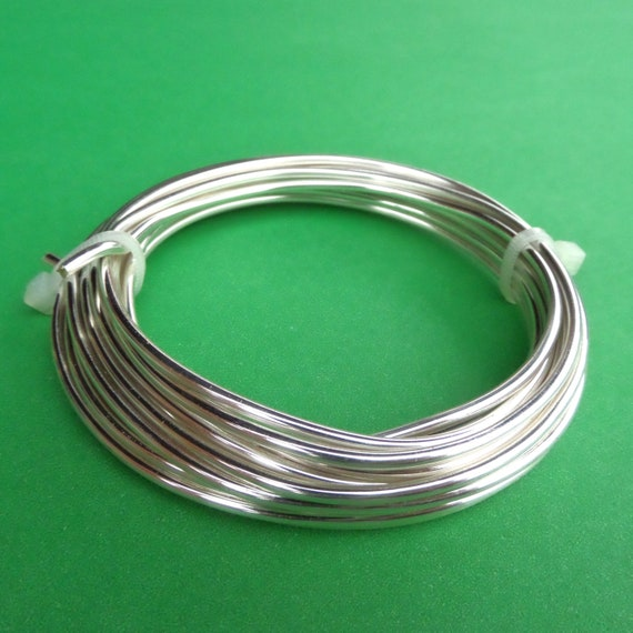Silver Plated Wire 10 Feet 12 Gauge Silver Plated Copper Wire with Clear Non Tarnish Coating.  Lead Free Made in USA