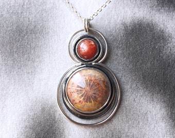 Ripple Effect fossilized coral pendant with sunstone, sterling silver art necklace, sunset colours, water ripple design, life-change gift