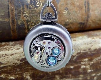Locket - Steampunk jewelry necklace - Hand holding Double locket Aquamarine Swarovski crystals - Watch parts - Pendant- Necklace