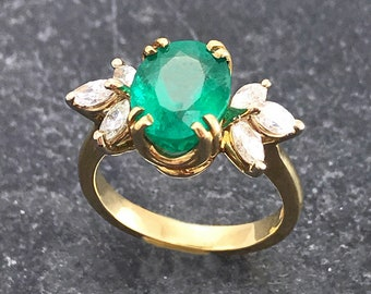 Fancy oval cut Emerald and Diamond ring (R929)
