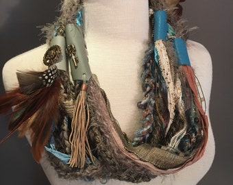 New - Handmade Boho Scrappy Embellished Infinity with leather straps, rivets, hand dyed and quail feathers,  Knit necklace, tribal, artwear