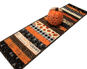Halloween Quilted Table Runner in Black and Orange - Bats, Skulls, Pumpkins!  Strippy and Scrappy Handmade Patchwork Quilt