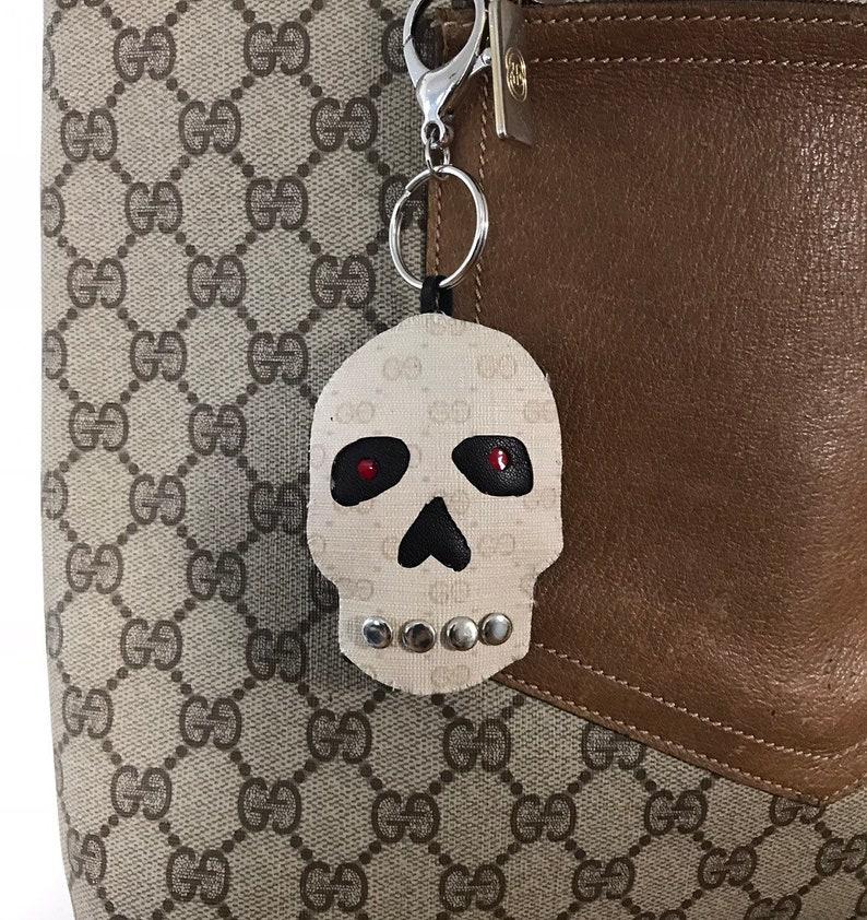 da9d0935f39704 Micro monogram Gucci skull with silver studs. | Etsy