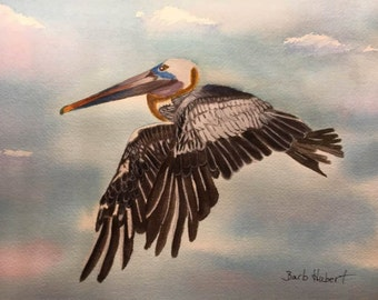 """Pelican Fly Bye, an Original 12"""" x 9"""" Watercolor of a Pelican in flight in a Vivid Sky with Pinks and Blues, Unframed"""