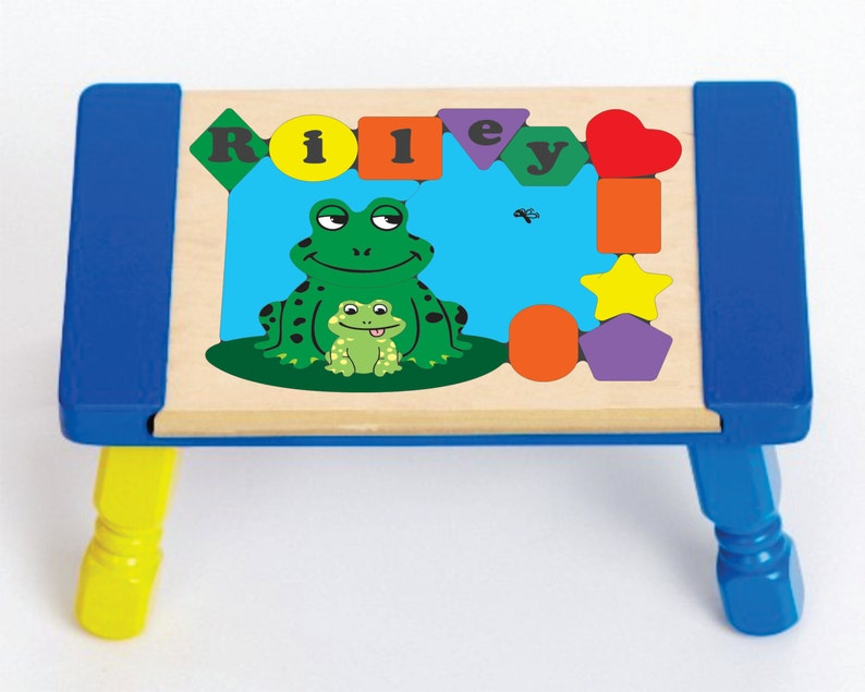 Personalized Name Puzzle Stool Frog Theme colors and name. An educational toy that your children will leap into learning their shapes