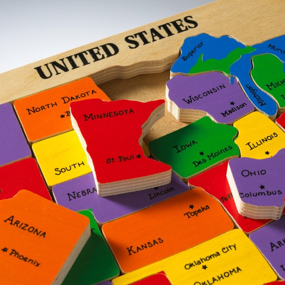 US Map Puzzle. Educational toy puzzle for learning and teaching preschool  elementary school children their states and capitals.